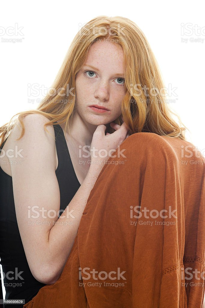 Pretty girl with long red hair wearing brown dress. royalty-free stock photo
