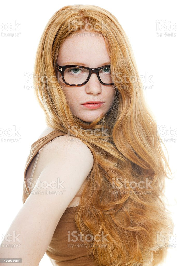 Pretty girl with long red hair wearing retro glasses. royalty-free stock photo