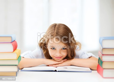 istock pretty girl with many books at school 462268645