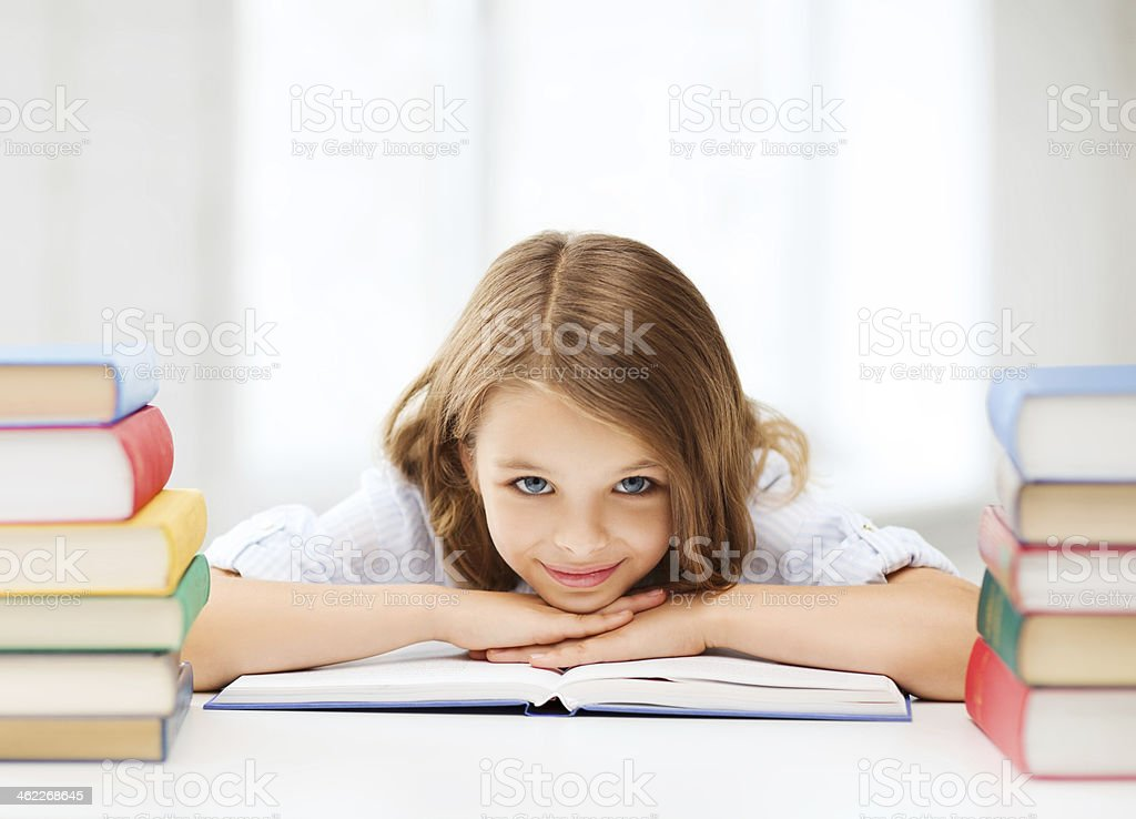 pretty girl with many books at school stock photo