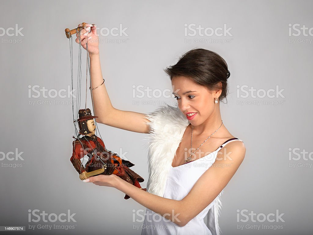 Pretty girl with marionette royalty-free stock photo