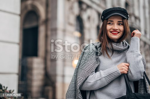 518885222istockphoto Pretty girl with red lipstick 1135805766