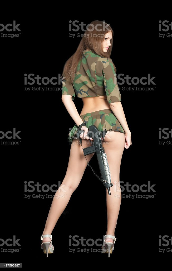 Pretty girl with rifle Young beautiful woman in sexy uniform with rifle, Back view 20-24 Years Stock Photo
