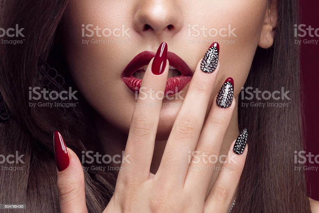 Pretty girl with unusual hairstyle, bright makeup, red lips and