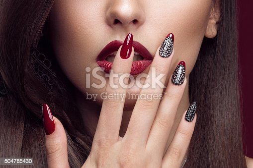 istock Pretty girl with unusual hairstyle, bright makeup, red lips and 504785430
