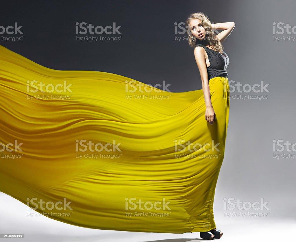 Pretty girl with yellow dress stock photo