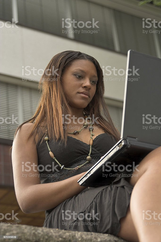 pretty girl working with laptoip outdoors royalty-free stock photo