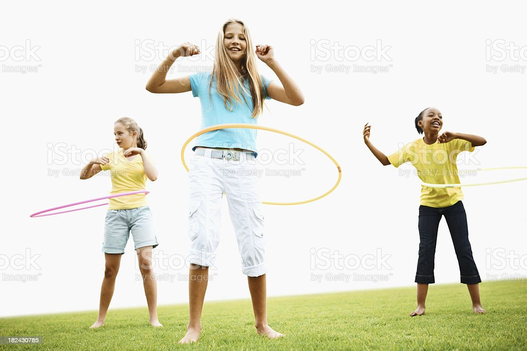 Pretty girls playing with hula hoop royalty-free stock photo