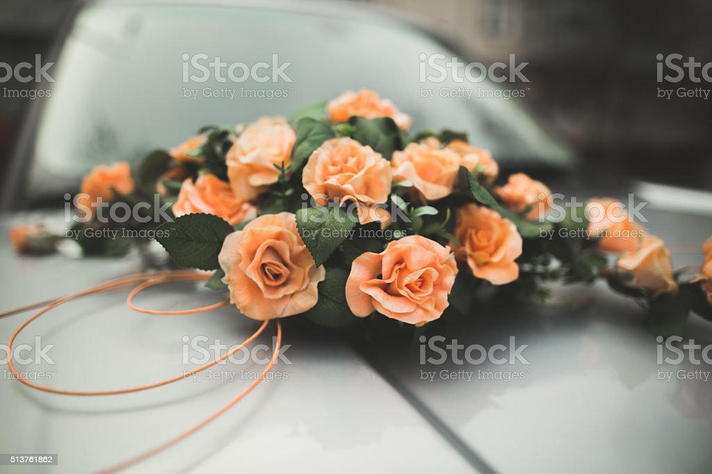 Pretty good wedding bouquet of various flowers on car stock photo