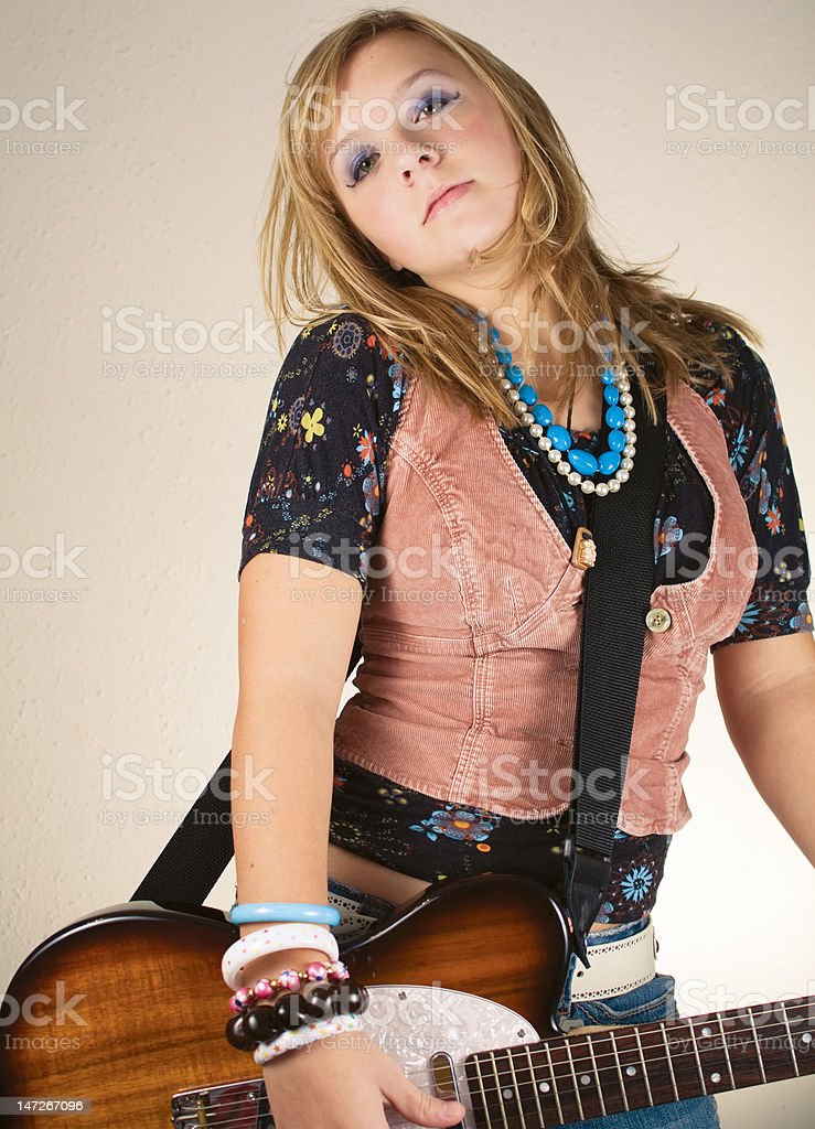 Pretty guitar rocker girl. stock photo