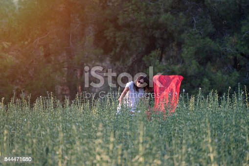 521982322 istock photo Pretty Happy women relaxing and dancing on a grass 844471680