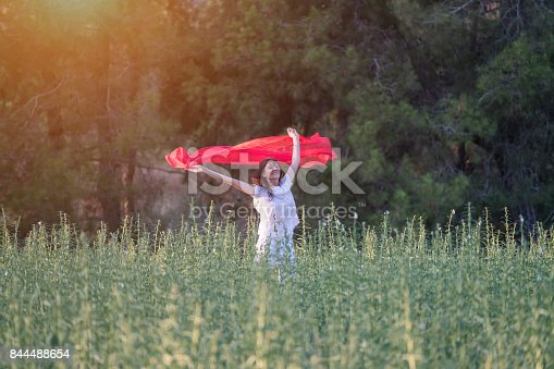 521982322 istock photo Pretty Happy women relaxing and dancing on a grass 844488654