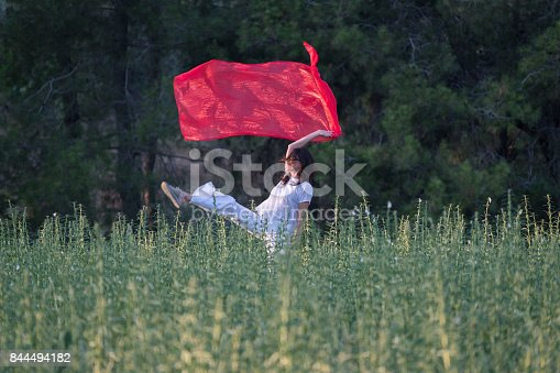 521982322 istock photo Pretty Happy women relaxing and dancing on a grass 844494182