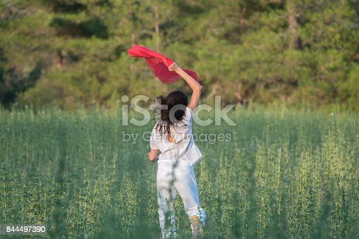 521982322 istock photo Pretty Happy women relaxing and dancing on a grass 844497390