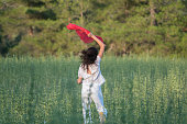 istock Pretty Happy women relaxing and dancing on a grass 844497390