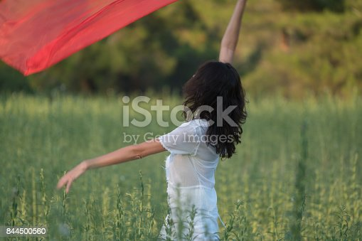 521982322 istock photo Pretty Happy women relaxing and dancing on a grass 844500560