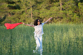 istock Pretty Happy women relaxing and dancing on a grass 844504180