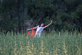 istock Pretty Happy women relaxing and dancing on a grass 844507590