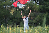 istock Pretty Happy women relaxing and dancing on a grass 844515264