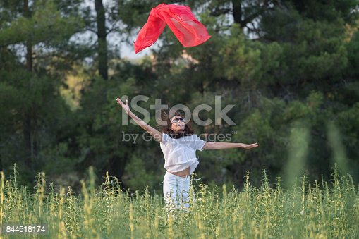 521982322 istock photo Pretty Happy women relaxing and dancing on a grass 844518174