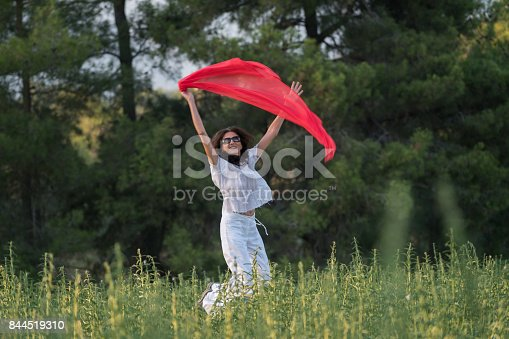 521982322 istock photo Pretty Happy women relaxing and dancing on a grass 844519310