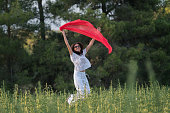 istock Pretty Happy women relaxing and dancing on a grass 844519310