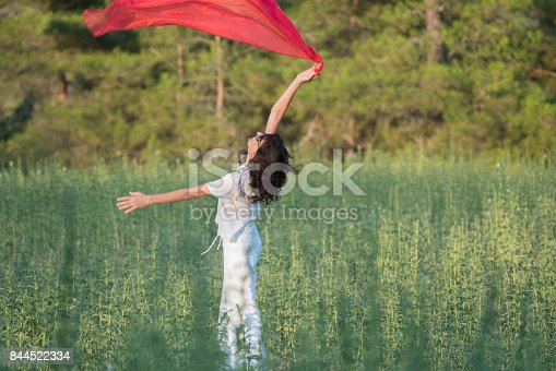 521982322 istock photo Pretty Happy women relaxing and dancing on a grass 844522334