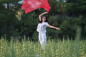 istock Pretty Happy women relaxing and dancing on a grass 844525610