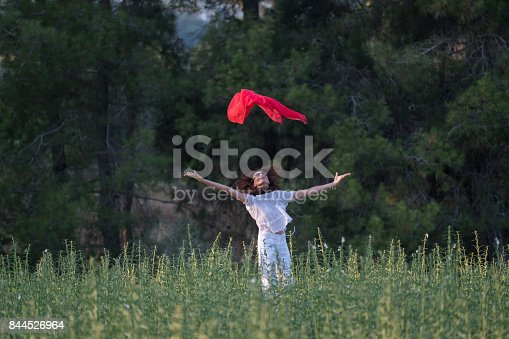 521982322 istock photo Pretty Happy women relaxing and dancing on a grass 844526964
