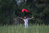 istock Pretty Happy women relaxing and dancing on a grass 844526964