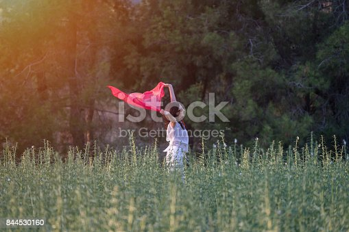 521982322 istock photo Pretty Happy women relaxing and dancing on a grass 844530160