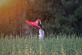 istock Pretty Happy women relaxing and dancing on a grass 844530160
