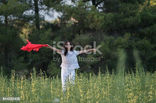 521982322 istock photo Pretty Happy women relaxing and dancing on a grass 844533408