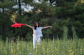 istock Pretty Happy women relaxing and dancing on a grass 844533408