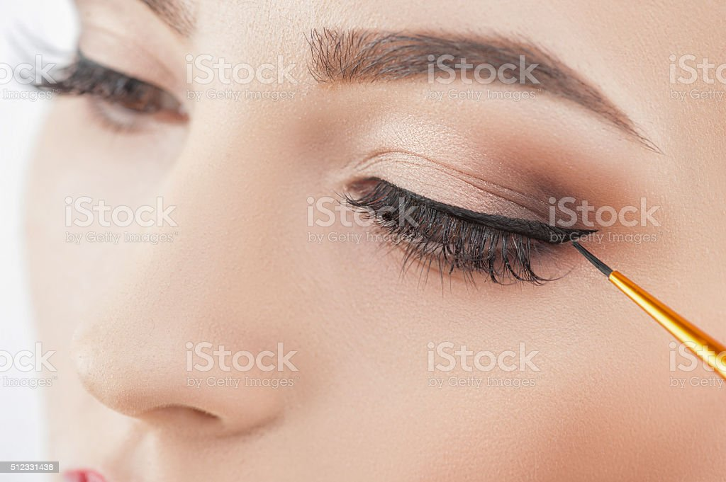 Pretty healthy girl in doing wonderful make-up stock photo