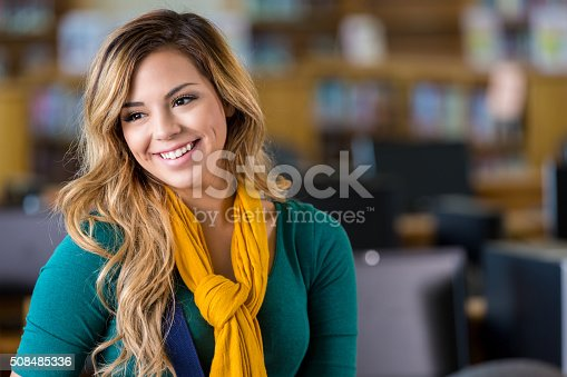 istock Pretty high school or college student in library 508485336