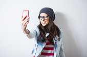 istock Pretty hipster girl taking selfie and making duck face 473702282