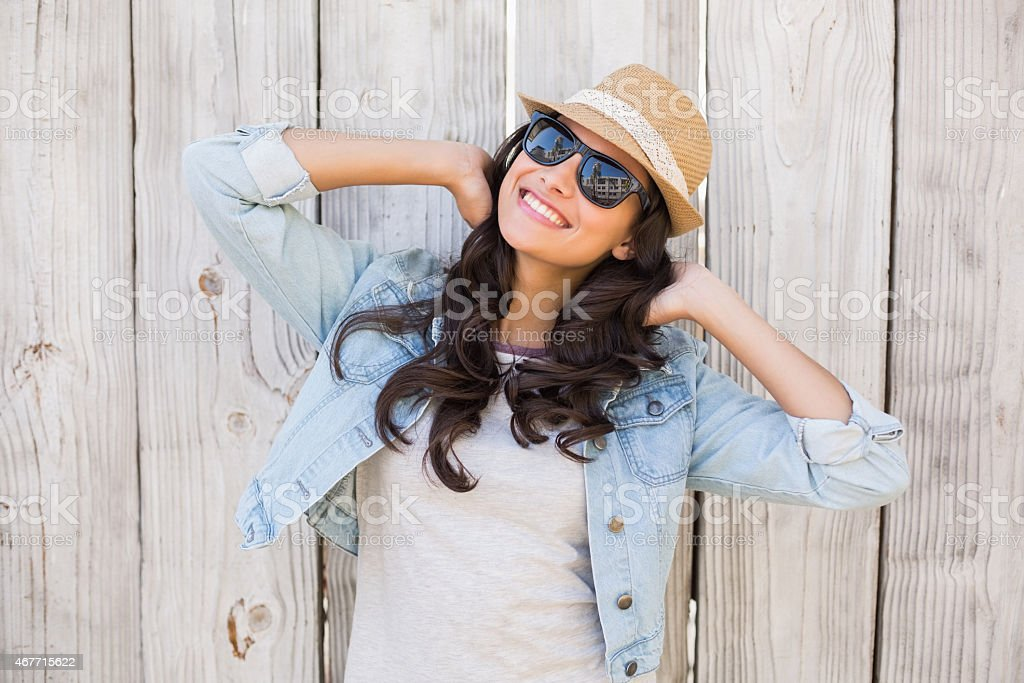 Pretty hipster smiling at camera stock photo