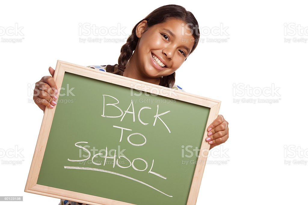 Pretty Hispanic Girl Holding Chalkboard with Back To School royalty-free stock photo
