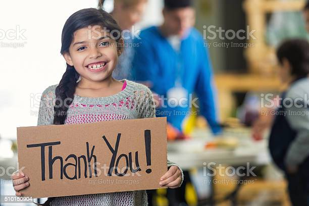 Pretty hispanic girl holds thank you sign in soup kitchen picture id510150904?b=1&k=6&m=510150904&s=612x612&h=ohphngkatnojjpobldmrgyo7fwqdmnj1zpocpd3udwc=