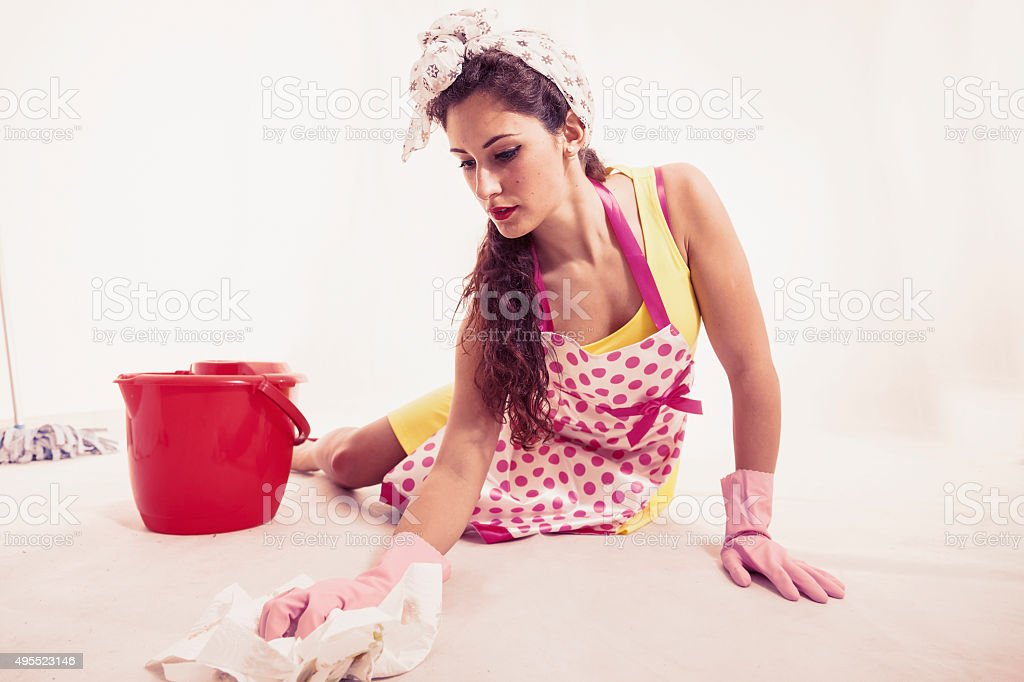 pretty housemaid with cloth and bucket cleaning the floor stock photo
