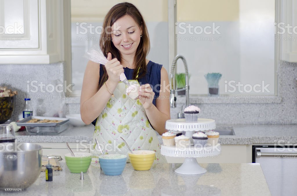 pretty housewife making cupcakes stock photo