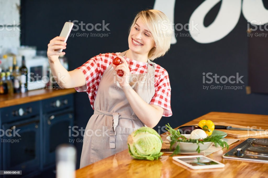Pretty Housewife Taking Selfie stock photo