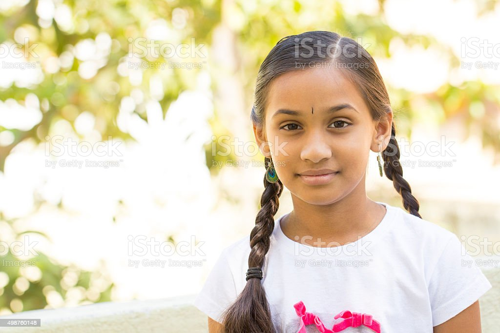 Pretty Indian teen girl stock photo