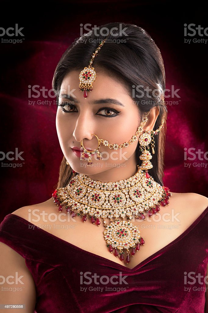 Pretty Indian women portrait with bridal jewelry stock photo