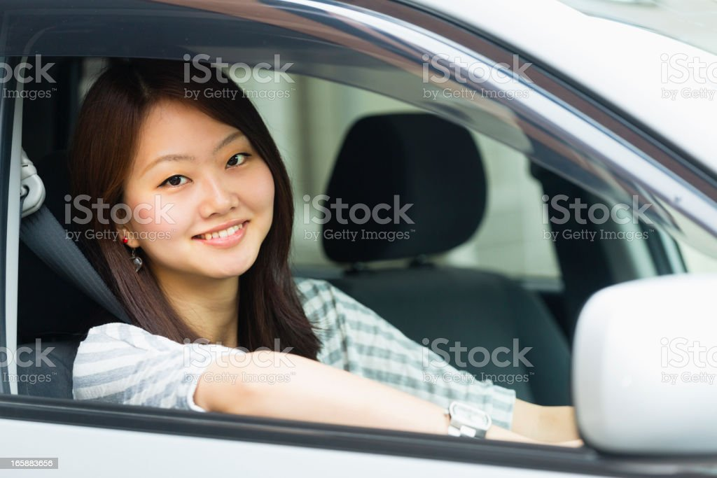 Pretty Japanese Woman Driving a Car stock photo