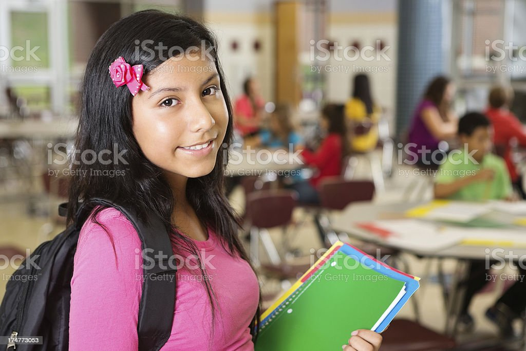 Pretty jr. high school student waiting for class to start royalty-free stock photo