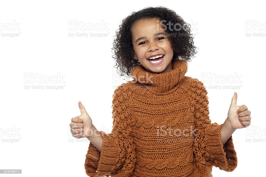 Pretty kid laughing and showing double thumbs up royalty-free stock photo