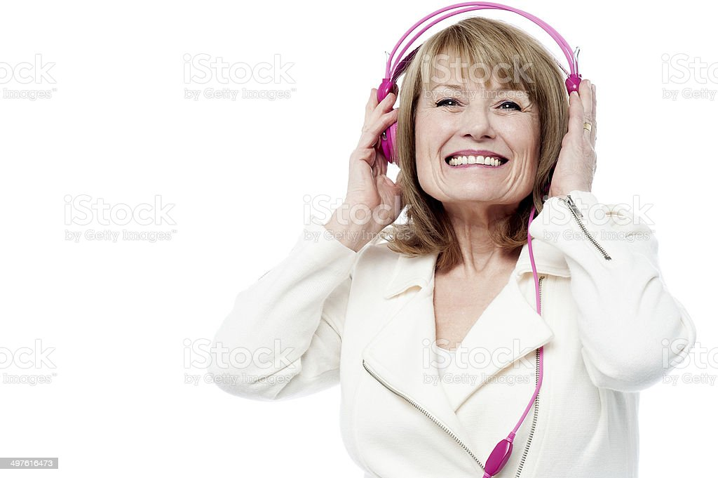 Pretty lady enjoying rock music royalty-free stock photo