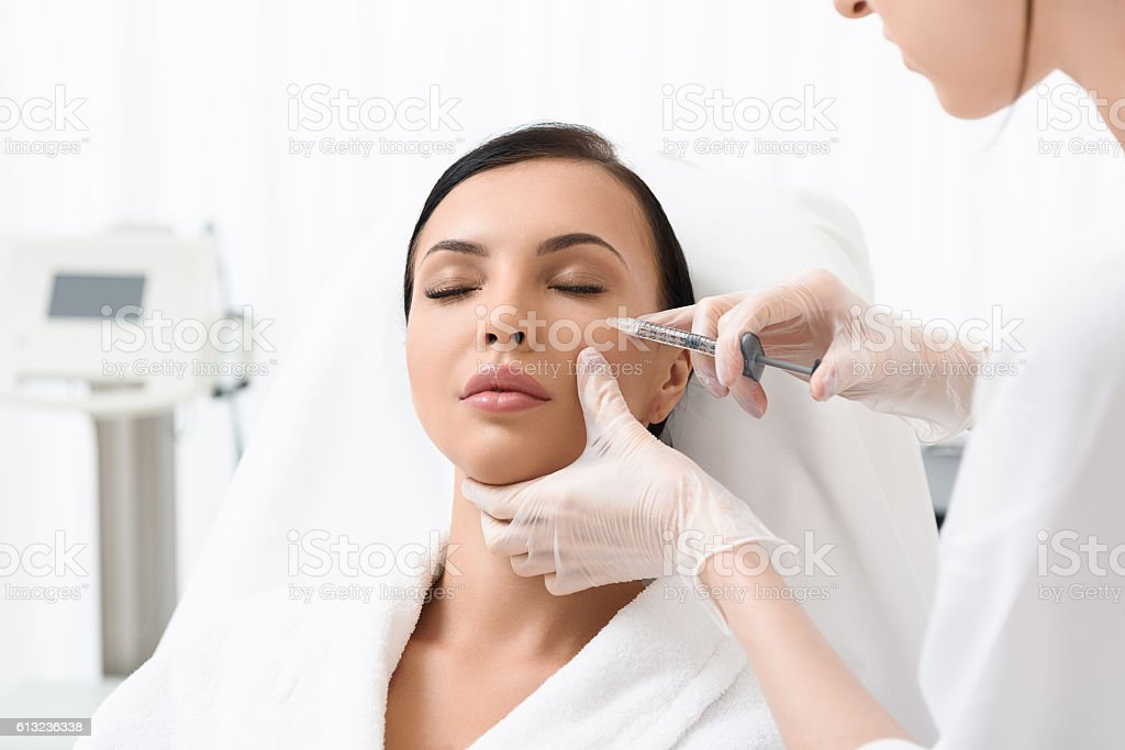 Pretty lady having skincare treatment – Foto